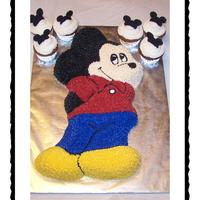 Mickey Mouse Cake & Cupcakes Cake was baked in Wilton's Novelty Mickey Mouse pan. Mickey Mouse ears for cupcakes are made with RI.