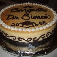 Cheesecake For Phd Graduation  This was for a friend who hates cake, but loves cheesecake. This was my first cheesecake. I wanted to celebrate his PhD and couldn't...