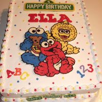 Baby Sesame Street Cake For my niece's first birthday...this was my first chocolate transfer. I used candy melts for the characters and the street signs on...