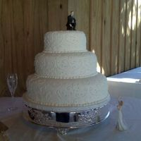 Resized_Lauren.jpg Wedding cake done with fondant icing and royal scroll work. tfl.
