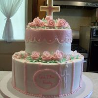 Resize_Comunion.jpg   6 and 10 inch rounds with buttercream icing, roses and white chocolate cross.