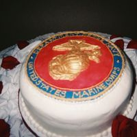 Resized_Marine_Grooms.jpg   12 inch round. whit chocolate marine emblem painted with gold luster dust. TFL.