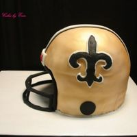 Saints  Football helmet for a groom. This one was fun. I used a 9 inch round with wilton soccer ball pan on top. covered in fondant and airbrushed...