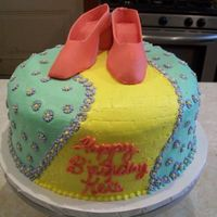 "Resized_Ruby_Shoes.jpg   10"" round iced in buttercream. Gumpaste slippers and fondant ""poppies."" TFL"