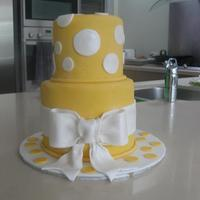 Polka Dots And Bow A small cake for my niece who turned 10. 6 inch and 4 inch tiers, chocolate cake with chocolate ganache, covered in sugarpaste with...