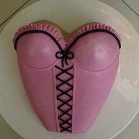 Pink Bustier Cake I made this for my DH's 49th birthday using the wilton dolly varden pan (I think that's what it's called) and a 9 inch...