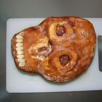 P1020783A.jpg That's 2d chocolate-coffee scull which I made for the grill party. The filling is chocolate-mascarpone, under fondant: all butter...