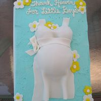 Baby Belly The cake is buttercream with fondant for the shirt.