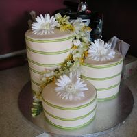 3 Tower Wedding Cake I made this for my friends wedding. It is a key lime pie poundcake covered in fondant icing with silk flowers.