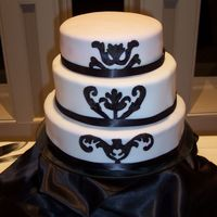 "Black And White Anniversary 3 tiered (14. 10. 8) 3 flavored cake, fondant covered. Hand painted design. Painted with gel colour ""watered down"" with vodka. I..."