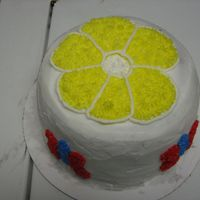 Daisy Cake This cake was done for my nieces birthday. It's an ice cream cake made with the betty crocker bake n fill pan. I just freehanded the...