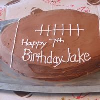 Football Cake This cake I did for my nephew's birthday. He wanted an ice cream football cake so I made 2 13x9 cakes, put ice cream in between the...