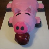 Pig Cake This is my first sculpted cake ever! He's made with red velvet cake and completely covered with 1 piece of fondant. I actually made...
