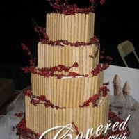 Hexagon Cake With Pirouettes And Berry Branches This was a simple cake that got a lot of attention at the bridal show. It was made simply with pirouette wafer cookies and berry branches....