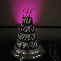 Zebra Cake! This was a four tier cake of Milk Chocolate and Sour Cream Almond with dark chocolate fondant stripes and eggplant satin ribbons per the...