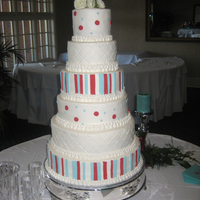 Pool Blue And Apple Red Towering Cake This was a 6 tier beast of a cake with layers of strawberry, Sour Cream Almond, and Milk Chocolate. Fondant Accents-the bride saw a photo...