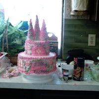 My 1St Castle Cake And My Messy Kitchen! This is my 1st castle cake. I drew inspiration from a the Disney Pincess Castle cake from DecoPac and a cake design from Wilton booklet...