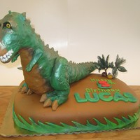 T-Rex Birthday T-Rexs is made from rice crispy treats with a fondant overlay. Everthing but the trees is completely edibile.