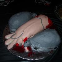 Finger Lickn' Good Done for a Halloween Party! Arm and Rats are both Cake. Blood is just red color mixed with corn syrup. TFL!