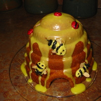 Beehive Cake   Lemon Poppy Seed cake with lemon glaze. Bees are buttercream with almond wings.