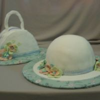 Hat And Purse  Cakes for my mother, SIL, DIL and for myself. Classic yellow cake with BCI and then Satin Ice Fondant on the hat. I ran out of energy and...
