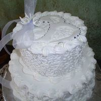 "White Wedding Cake, Well Kinda... This is a cake I made for My 11 year old niece for her birthday. She wanted a ""Frilly white wedding cake."" I've never done a..."