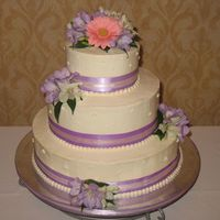 My First Wedding Cake Yeah! I am so excited. This is my first wedding cake. Yellow cake with chocolate buttercream filling and fresh flowers. A lot of work but a...