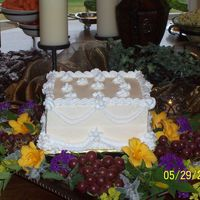 "Bridal Shower Cake  This is a white/almond 8"" cake with BC icing. I wasn't very happy with my swags and flowers but after they put all of the..."