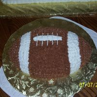 "Football Cake This is the football cake that went along with the football field cake I made. It is milk chocolate cake with ""granny's""..."