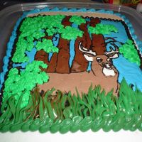 Deer made this for a friend who wanted a cake for her boyfriend. He is really into hunting so this is what I came up with. The whole scene is a...