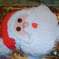 Santa Simple santa cake I made for christmas. Thought I was going to kill my husband on this one, He put some of his home-made hard candy next to...