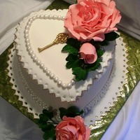 Anniversary Cake WASC with vanilla buttercream. Roses, ivy and key are gumpaste. Cake is covered in fondant and decorated with fondant pearls and lace. I...