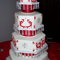 Friends Wedding Butter cake with vanilla buttercream. Decorated with fondant red scrolls and silver dragee accents.