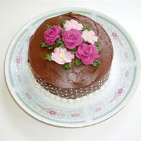 Pink Flowers A small (6 inch) cake that I wanted to coordinate with the plate, but using chocolate icing. Royal icing flowers.