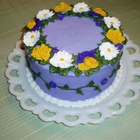 Spring Flowers Side/top view of a cake I made for my women's Bible study. I just wanted to make a purple cake! Royal icing flowers.
