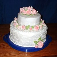 Wilton Course 3 Grad Cake I rolled the fondant a little thin. Especially for a chocolate cake, but I really like how my fondant roses and babysbreath turned out. I...