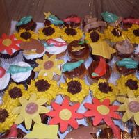 Cupcake_Tower_Cupcakes.jpg Vanilla and Chocolate cupcakes made for a western cupcake tower topped with a western fondant cut out or chocolate candy mold