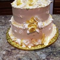40Th Anniversary Cake Two tier Butter cake filled and topped with butter cream frosting decorated with gum paste roses and air brushed with gold and pearl luster...
