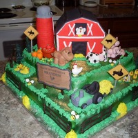 Barnyard Birthday Cake Two Tier White Cake filled and frosted with white butter cream frosting air brushed topped with a gum paste barn made with pound cake (...