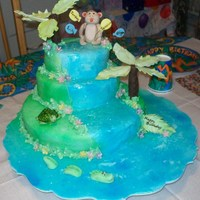 Birthday Island  Chocolate and vailla cakes cover in MMF. The figures are all fondant, the palm tree is made out of modeling chocolate. The crocadile was...