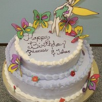 Tinkerbell Tiered Cake Liquid chocolate Tinkerbell and butterflies. White chocolate buttercream (WCBC), chocolate cake with chocolate filling, vanilla cake with...