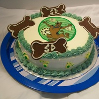 Scooby Doo   Fundraiser cake. modeling chocolate dog bones. white chocolate buttercream blueberry yogart cake.