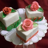 Roses   cake dummies. gumpaste roses and leaves.