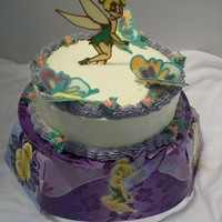 Tinkerbell Tinkerbell cake made for the school fundraiser. Liquid Chocolate Transfer of Tinkerbell. White chocolate butter cream with blueberry cake...