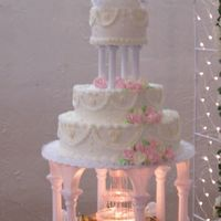 My First Wedding Cake White cake throughout, buttercream icing with ryal icing flowers. Accented by Wilton's fountain flowing with pink water.