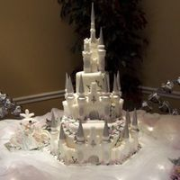 Castle Wedding Castle wedding cake in fondant. Castle is sugar mold. The carriage is also a sugar mold, Prince and Princess are Disney characters.