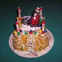 Santa On Bike Castle bundt cake mold. Chocolate santa mold with dustings. Royal icing snow, purchased candies.