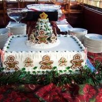 Gingerbread People And Tree 18x24 double layer yellow cake, buttercream frosting. Gingerbread cookie people decorated with royal. The tree is gingerbread cookies with...