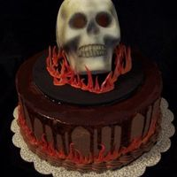 Sugar Skull Cake Molded sugar skull, dusted with black. Ganache over cake. Flames are gumpaste.
