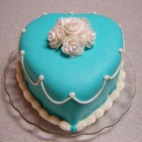 Tiffany Blue Rose Cake This was the cake I made for my moms birthday. It was the first time I had ever covered a heart shaped cake in fondant and the first time I...